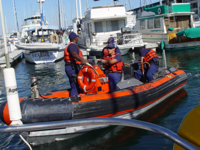 Members of U.S. Coast Guard boarding party departs the dock in their orange and black inflatable boat , Marina del Rey, California - Click for larger image (http://jamesmcgillis.com)